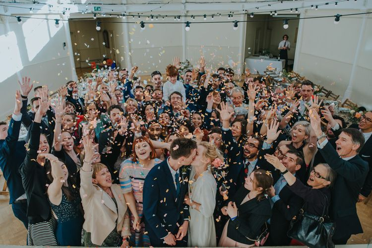 Confetti Moment | Bride in Wrap Front Wedding Dress | Groom in Navy Suit | Coral Peony Wedding at The Tab Centre Shoreditch | Remain in the Light Photography