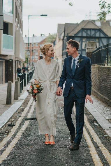 Bride in Wrap Front Wedding Dress | Groom in Navy Suit | Coral Peony Wedding at The Tab Centre Shoreditch | Remain in the Light Photography