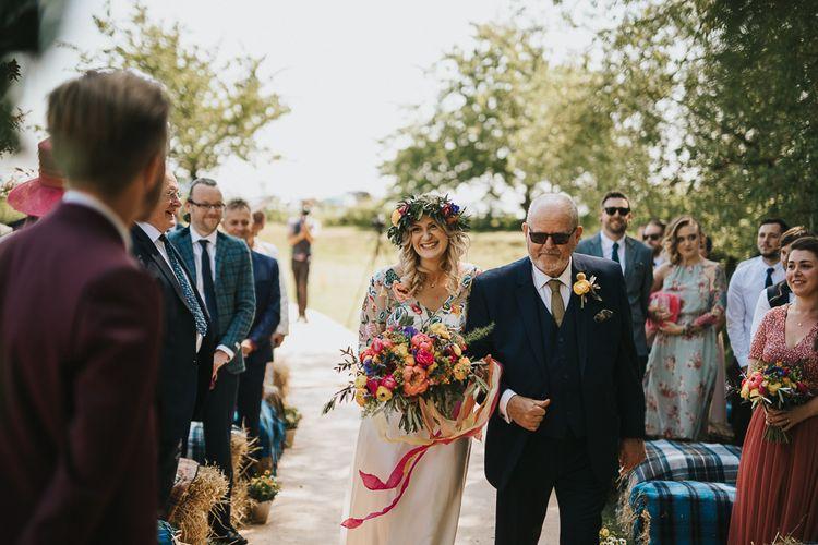 Outdoor Wedding Ceremony Bridal Entrance in Colourful Embroidered Luna Bride Wedding Dress
