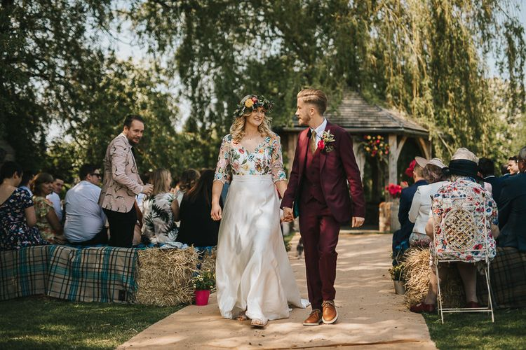 Bride in Colourful Embroidered Luna Bride Wedding Dress and Groom in Burgundy Paul Smith Suit  Walking Up the Aisle as Husband & Wife