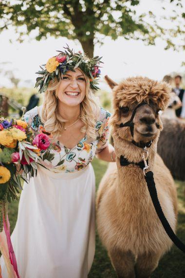 Bride in Colourful Embroidered Luna Bride Wedding Dress with Llama
