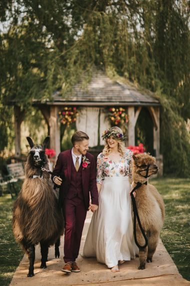 Bride in Colourful Embroidered Wedding Dress and Groom in Burgundy Paul Smith Suit  with Alpaca and Llama