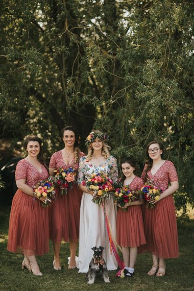 Bridal Party with Bride in Embroidered Luna Bride Wedding Dress and Bridesmaid in Pink Sequin and Tulle Maya Dresses from ASOS
