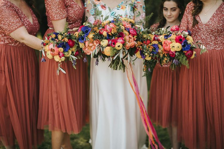 Bridal Party Colour Bouquets with Peonies, Ranunculus, anemones and foliage tied in ribbon
