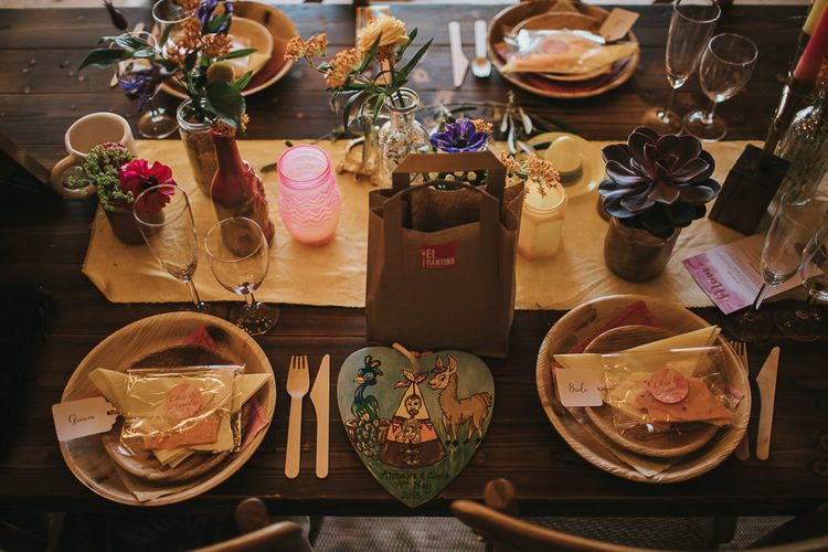 Place Setting with Wildflower Centrepieces, Succulents and Eco-friendly tableware