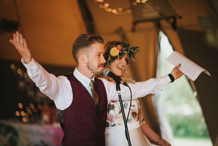 Groom in Burgundy Paul Smith Waistcoat Giving Wedding Speech in a Teepee