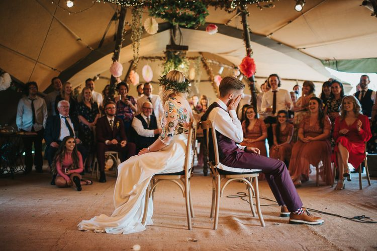 Bride in Colourful Embroidered Luna Bride Wedding Dress and Groom in Burgundy Paul Smith Suit Playing Mr & Mrs Game