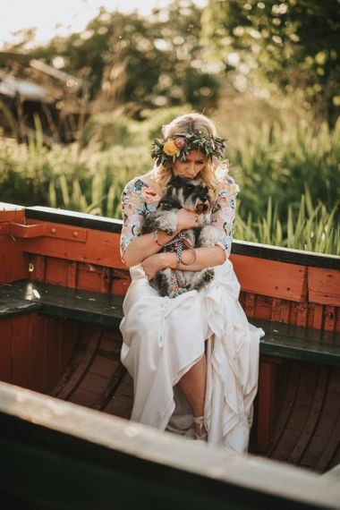 Bride in Colourful Embroidered Luna Bride Wedding Dress Holding Pet Dog on a Boat