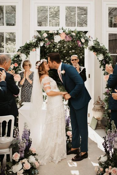 Bride and Groom Kiss During Ceremony