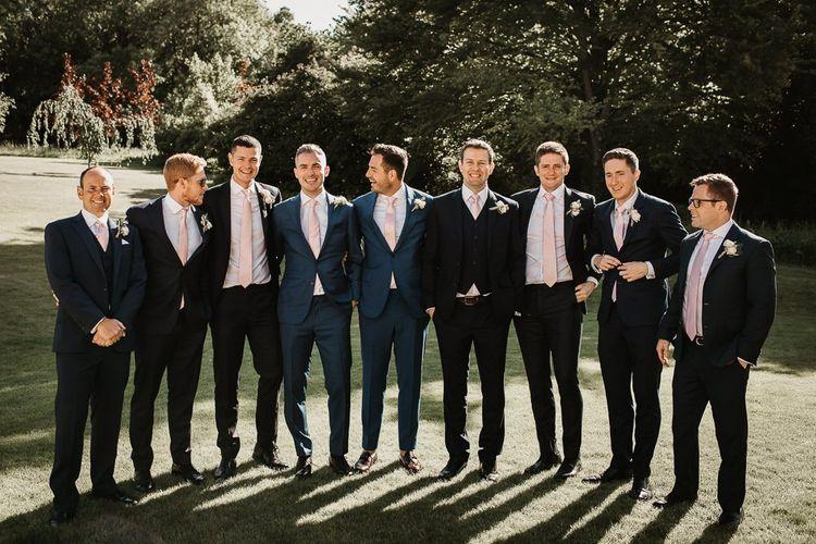 Groom and Groomsmen in Grey Suits with Pink Ties