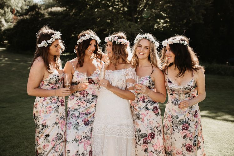 Bride in Lace Boho Dress with Bridesmaids in Floral ASOS Dresses