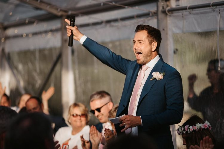 Groom Celebrating Whilst Making Speech During Reception