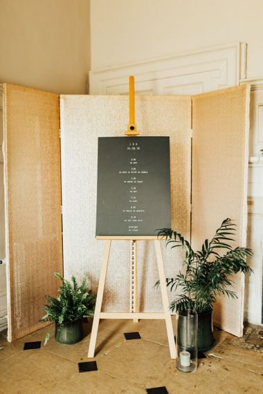 Gold Screen with Order of The Day Wedding Sign On Easel