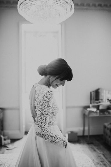 Bride in Lace Bodice Emma Beaumont Wedding Dress and Chic Chignon Hairstyle