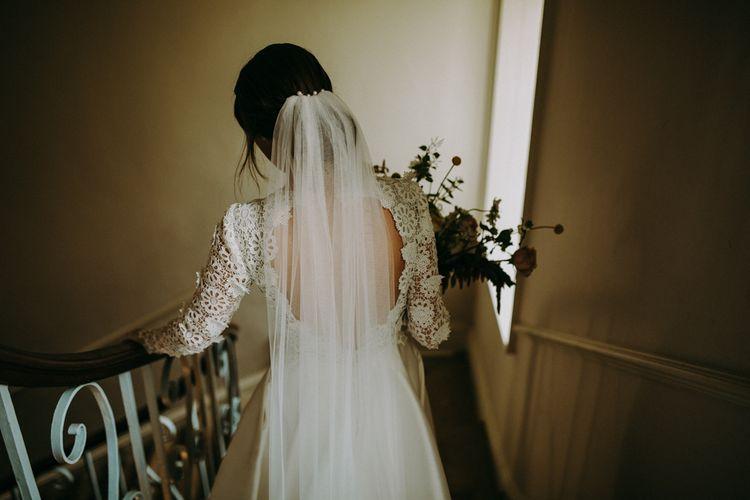 Bride in Applique Keyhole Back Emma Beaumont Wedding Dress  and Veil
