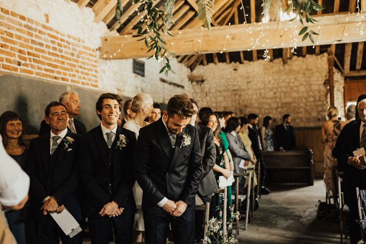 Groom at the Altar of Narborough Hall Gardens in Reiss Suit