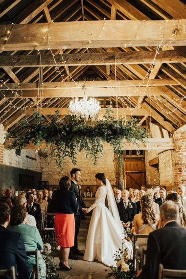 Bride and Groom Exchanging Vows at their Rustic Wedding Ceremony