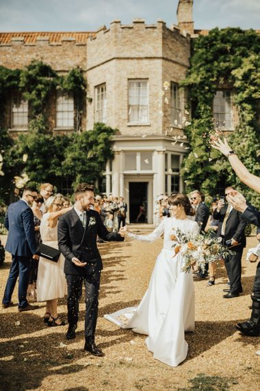 Confetti Moment with Bride in Emma Beaumont Wedding Dress and Groom in Reiss Suit