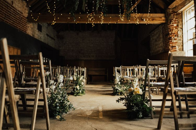 Ceremony Aisle Wedding Flowers at Narborough Hall  in Norfolk