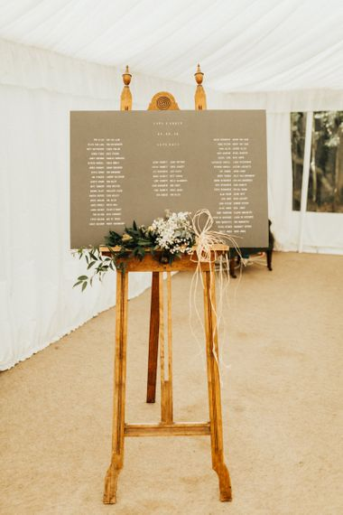 Grey Table Plan with White Font on Easel