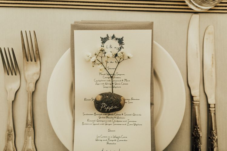 Place Setting with Menu Card, Pebble and Flower Stem