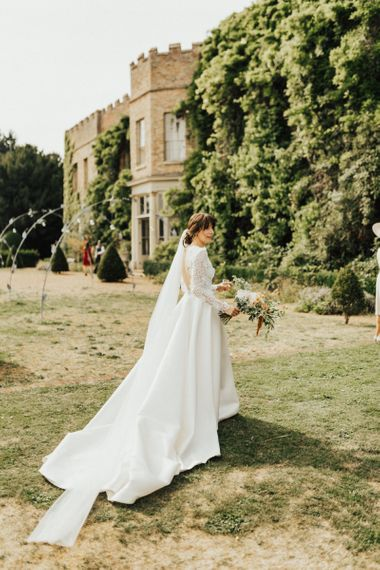 Beautiful Bride in Emma Beaumont Wedding Dress with Applique Bodice and Front Slit Skirt