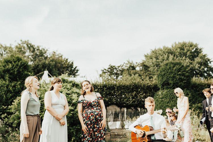 Wedding Guests Enjoying Guitarist Music