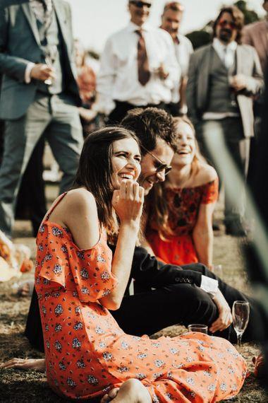 Wedding Guests Enjoying Outdoor Wedding Speeches