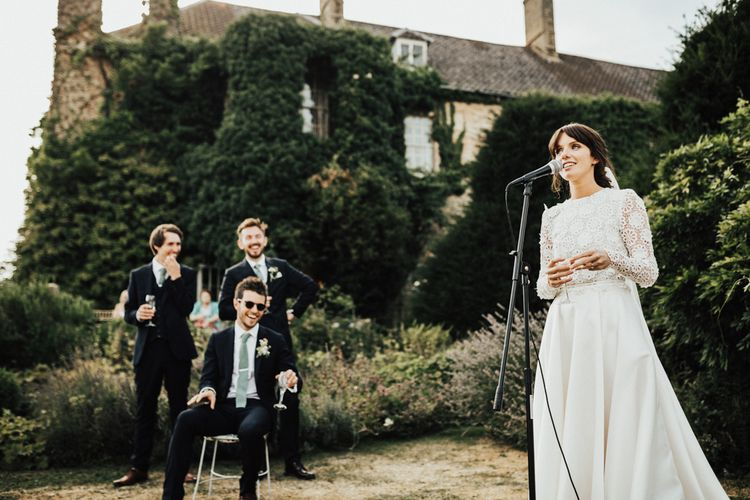 Bride in Emma Beaumont Wedding Dress Giving a Wedding Speech