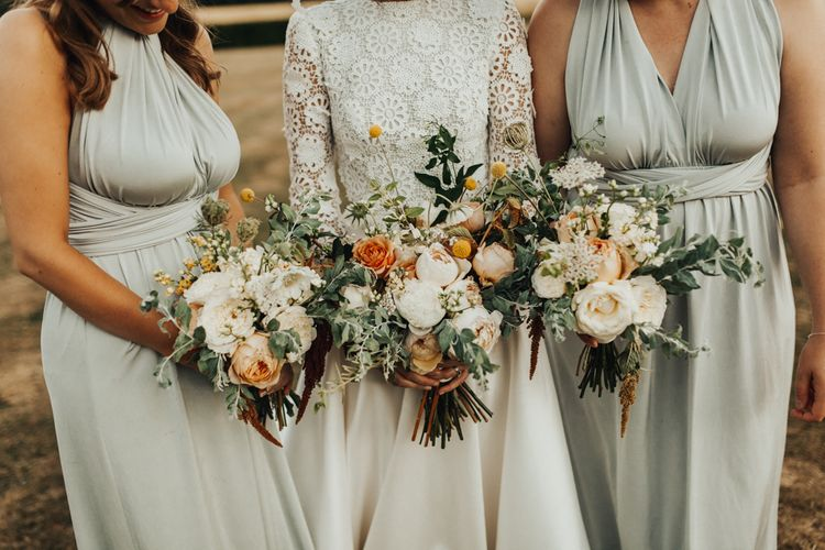 Delicate Bridal Party Bouquets with White and Peach Flowers and Foliage
