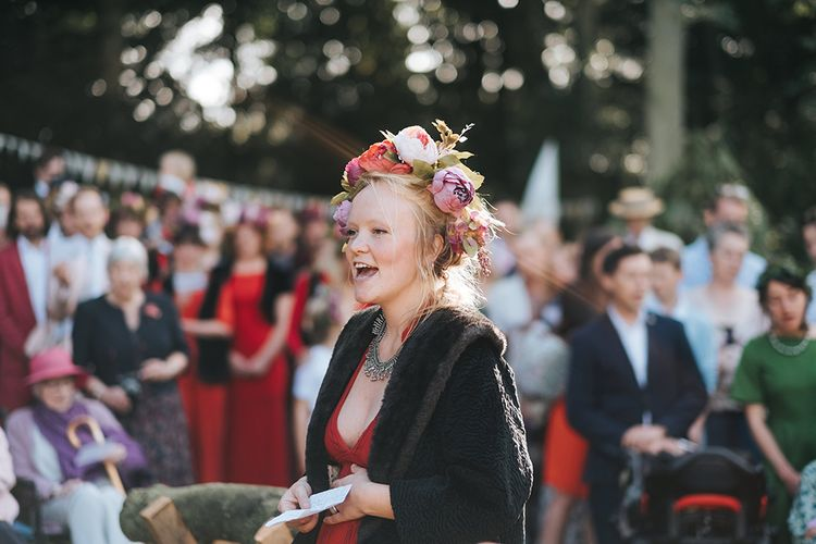 Wedding Ceremony | Bridesmaid in Red Dress & Flower Crown  | Outdoor Woodland Wedding at Wiveton Hall, Norfolk with Folk Festival Vibes | Miss Gen Photography