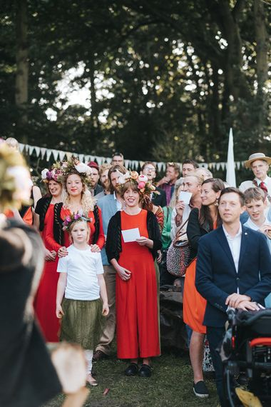 Bridesmaids in Red Dresses & Flower Crowns | Outdoor Woodland Wedding at Wiveton Hall, Norfolk with Folk Festival Vibes | Miss Gen Photography