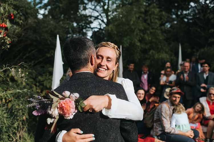 Wedding Ceremony | Bride in Reformation Gown | Groom In Tweed Suit | Outdoor Woodland Wedding at Wiveton Hall, Norfolk with Folk Festival Vibes | Miss Gen Photography