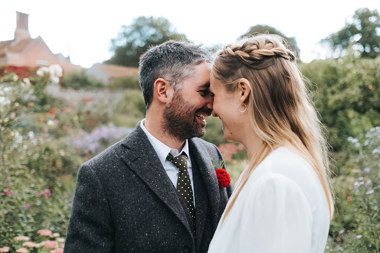 Bride in Reformation Gown | Groom In Tweed Suit | Outdoor Woodland Wedding at Wiveton Hall, Norfolk with Folk Festival Vibes | Miss Gen Photography