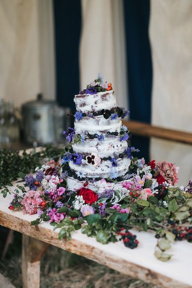 Semi Naked Wedding Cake with Fruit Decor | Outdoor Woodland Wedding at Wiveton Hall, Norfolk with Folk Festival Vibes | Miss Gen Photography
