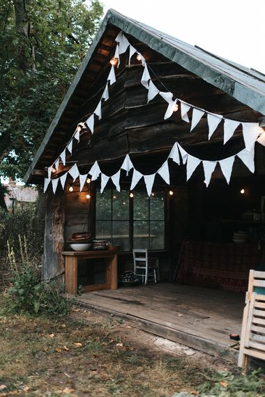 Bunting Wedding Decor | Outdoor Woodland Wedding at Wiveton Hall, Norfolk with Folk Festival Vibes | Miss Gen Photography