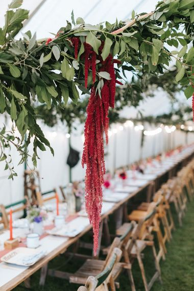 Hanging Red Wedding Flowers | Outdoor Woodland Wedding at Wiveton Hall, Norfolk with Folk Festival Vibes | Miss Gen Photography