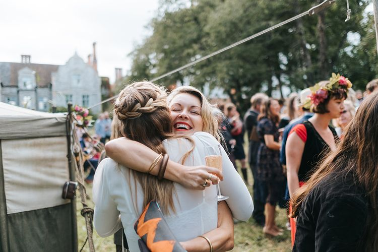 Hugs | Bride in Reformation Gown | Outdoor Woodland Wedding at Wiveton Hall, Norfolk with Folk Festival Vibes | Miss Gen Photography