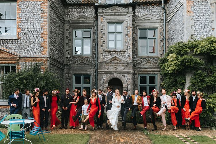 Wedding Party | Bride in Reformation Gown | Bridesmaids in Red Dresses | Groom In Tweed Suit | Outdoor Woodland Wedding at Wiveton Hall, Norfolk with Folk Festival Vibes | Miss Gen Photography