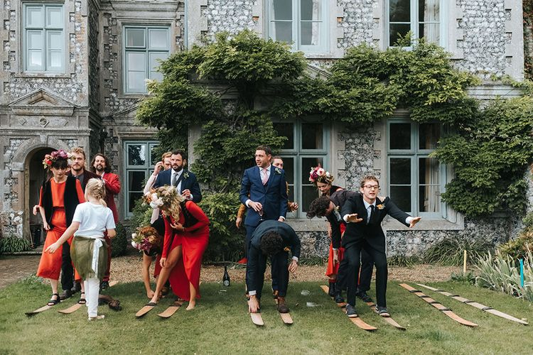 Wedding Party Games | Bridesmaids in Red Dresses | Outdoor Woodland Wedding at Wiveton Hall, Norfolk with Folk Festival Vibes | Miss Gen Photography