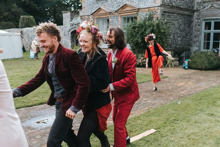 Wedding Party in Red | Outdoor Woodland Wedding at Wiveton Hall, Norfolk with Folk Festival Vibes | Miss Gen Photography