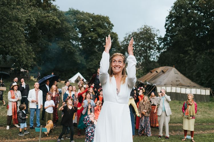 Bouquet Toss | Bride in Reformation Gown | Outdoor Woodland Wedding at Wiveton Hall, Norfolk with Folk Festival Vibes | Miss Gen Photography