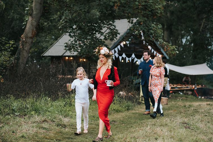 Bridesmaid in Red Dress | Outdoor Woodland Wedding at Wiveton Hall, Norfolk with Folk Festival Vibes | Miss Gen Photography