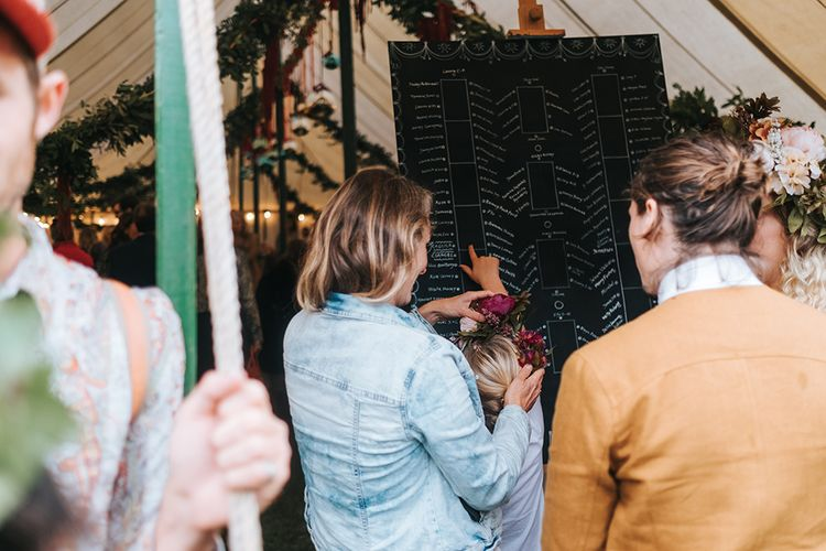Blackboard Table Plan | Outdoor Woodland Wedding at Wiveton Hall, Norfolk with Folk Festival Vibes | Miss Gen Photography