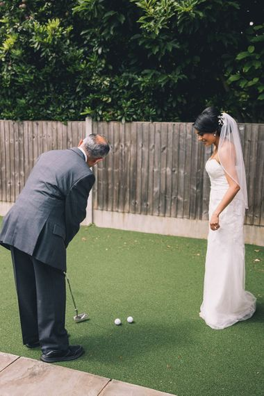Father of the bride and daughter putting in the garden
