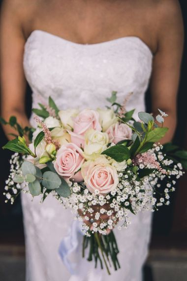 Wedding bouquet with pink and white roses , gypsophila and eucalyptus