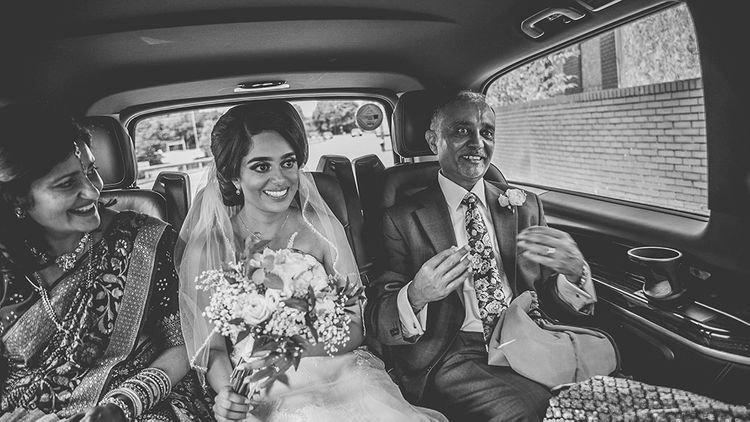 Bride and parents taking a cab ride to the wedding ceremony