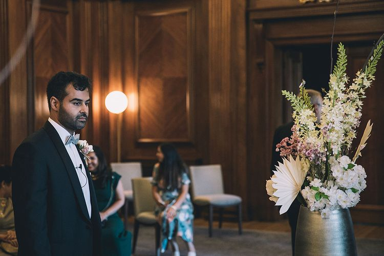 Groom waiting at the altar for his bride at July 2020 wedding