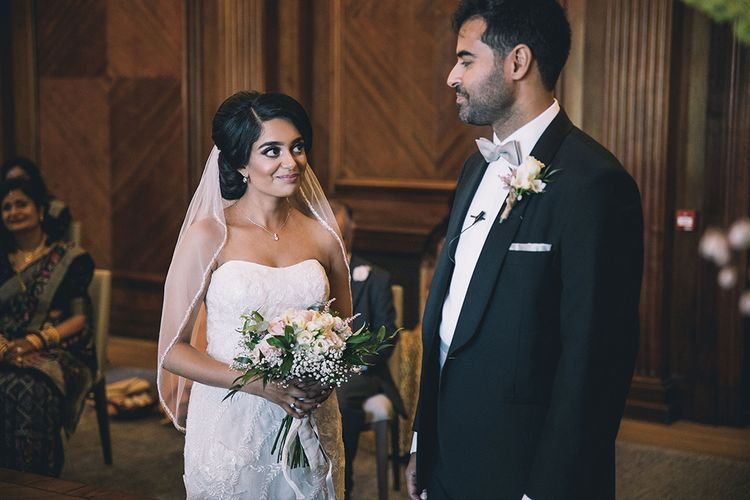 Bride and groom exchanging vows at COVID secure July 2020  wedding