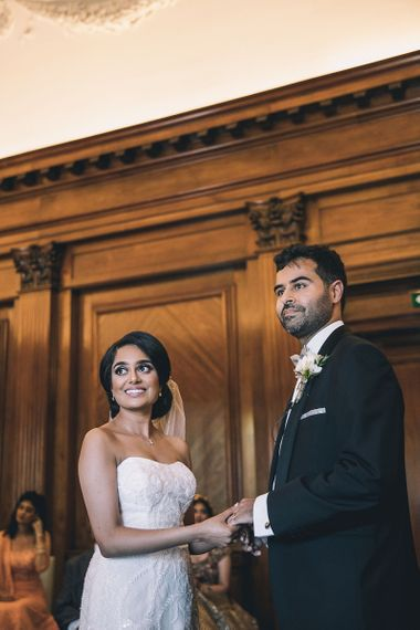 Bride and groom exchanging vows at socially distanced wedding